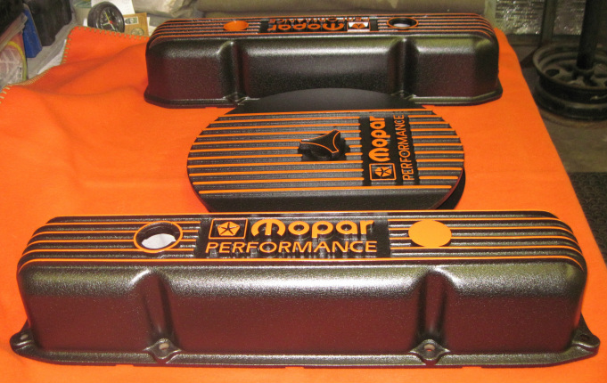 One-off custom Mopar Performance valve covers and air cleaner assembly in Hemi Orange and Wetstone Black