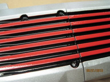 Close up of custom Jeep intake plenum in Alien Silver, Flag Red and Ink Black