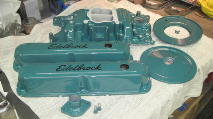 Small block Mopar Edelbrock intake manifold, air cleaner assembly, valve covers and water neck in Clear Vision over Sea Water Teal