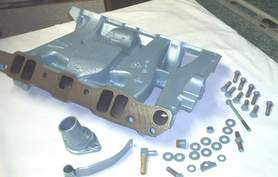 Bottom view of Pontiac intake manifold, pcv bracket and hardware in Poncho Blue