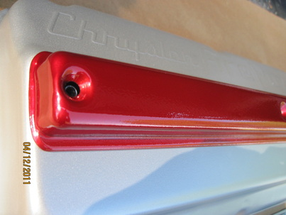 Chrysler FirePower hemi valve cover in Pacific Silver; cover in Wilder Red over Super Chrome