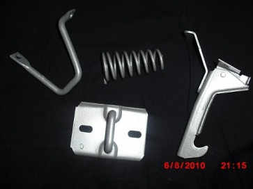 A Body Mopar hood latch assembly in Silver Glaze