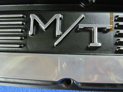 Close up shop photo of Mickey Thompson Mopar valve covers in Silk Satin Black with polished fins/logos
