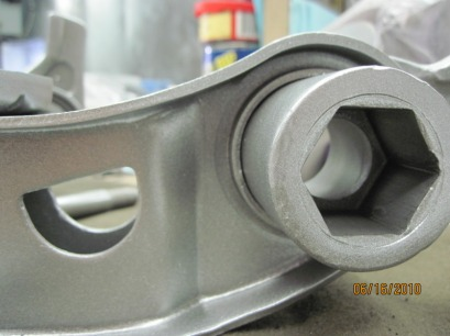 Close up of Mopar lower control arm in Alien Silver
