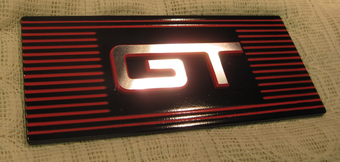Cobra fuse box cover in Flame Red, Ink Black and Clear Vision with custom matching billet GT emblem