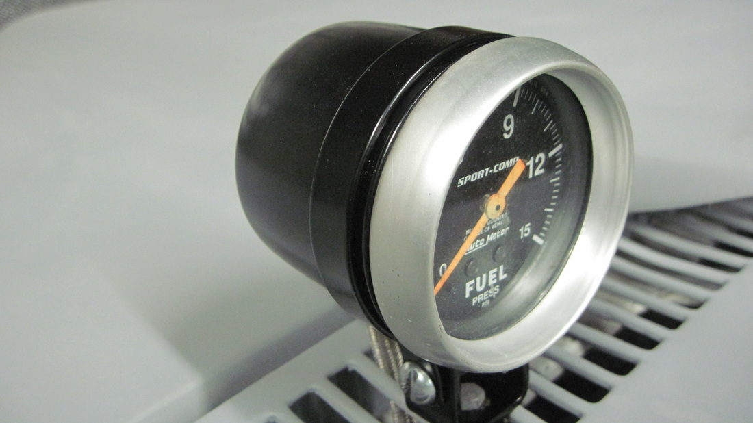 Fuel gauge cup assembly in Raven Black
