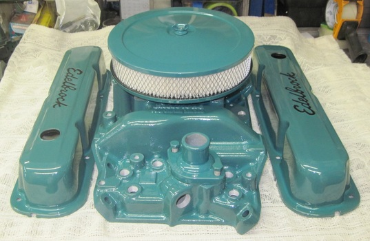 Small block Mopar Edelbrock valve covers, intake manifold and air cleaner in Sea Water Teal and Clear Vision